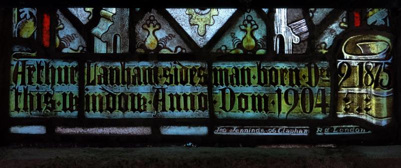 Inscription at base of right-hand light